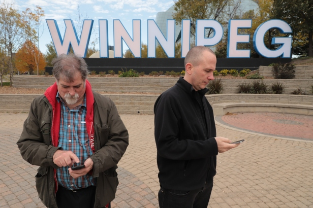 Dave Barber and Kevin Nikkel by Winnipeg sign Photo by Leif Norman